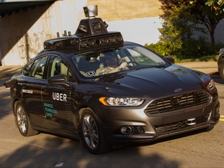 Self-driving Uber car gets in rollover crash